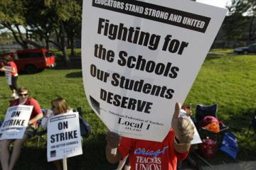 This sign from last summer's Chicago Teachers Union strike defines why and how parents and teachers can align.  (Source: Associated Press)