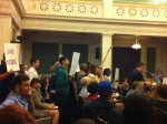 Parents and others line up to testify in favor of increasing city funding for schools.